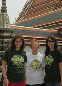 Judy Schuett with her daughters in Thailand.